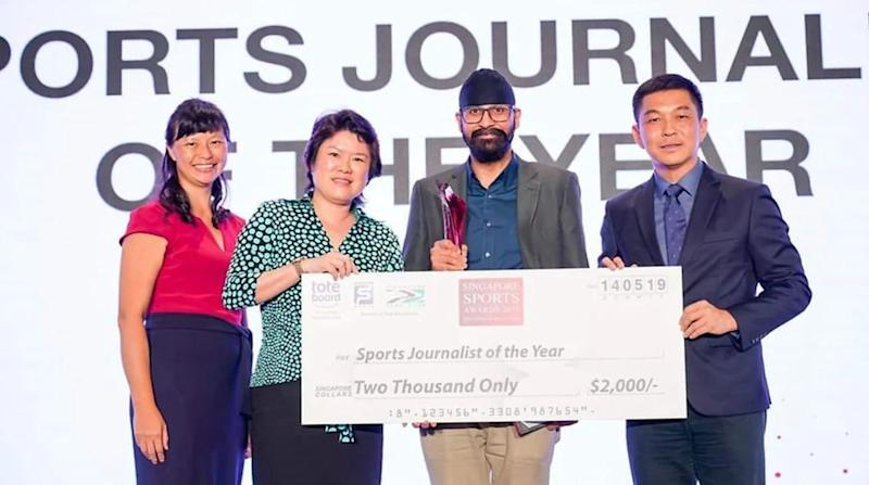 TNP's Dilenjit Singh (second from right) receiving the Sports Journalist of the Year award on 14 May, 2019. (PHOTO: Singapore National Olympic Council via SportSG)