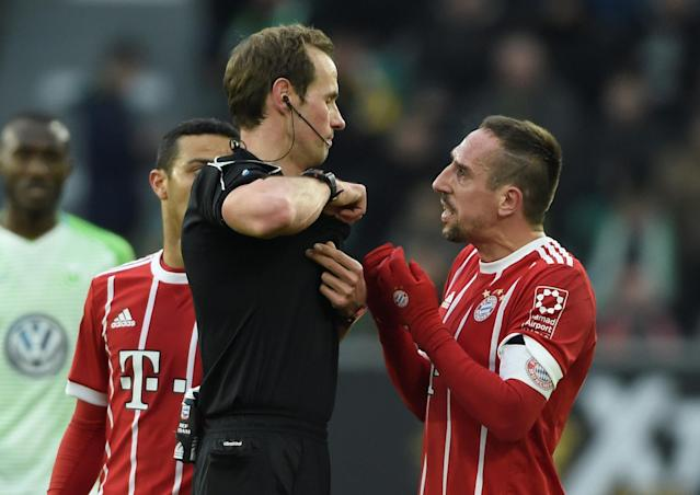 Soccer Football - Bundesliga - VfL Wolfsburg vs Bayern Munich - Volkswagen Arena, Wolfsburg, Germany - February 17, 2018 Bayern Munich's Franck Ribery is shown a yellow card by referee Sascha Stegemann REUTERS/Fabian Bimmer DFL RULES TO LIMIT THE ONLINE USAGE DURING MATCH TIME TO 15 PICTURES PER GAME. IMAGE SEQUENCES TO SIMULATE VIDEO IS NOT ALLOWED AT ANY TIME. FOR FURTHER QUERIES PLEASE CONTACT DFL DIRECTLY AT + 49 69 650050