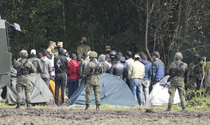Polish security forces block migrants stuck on the border with Belarus in Usnarz Gorny, Poland, on Wednesday, Sept. 1, 2021. Poland's government said Monday that it is sending 500 additional troops and special vehicles to the border with Belarus to strengthen it against increasing migrant pressure that it says is orchestrated by Belarus and Russia. (AP Photo/Czarek Sokolowski)