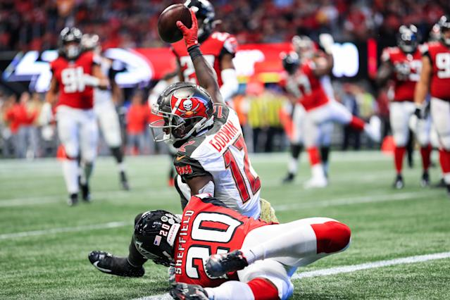 ATLANTA, GA - NOVEMBER 24: Chris Godwin #12 of the Tampa Bay Buccaneers catches a pass for a touchdown in front of Kendall Sheffield #20 of the Atlanta Falcons during the first half at Mercedes-Benz Stadium on November 24, 2019 in Atlanta, Georgia. (Photo by Carmen Mandato/Getty Images)