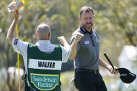 Jimmy Walker, right, fist bumps with his caddie following the first round of the Sanderson Farms Championship golf tournament in Jackson, Miss., Thursday, Oct. 1, 2020. (AP Photo/Rogelio V. Solis)