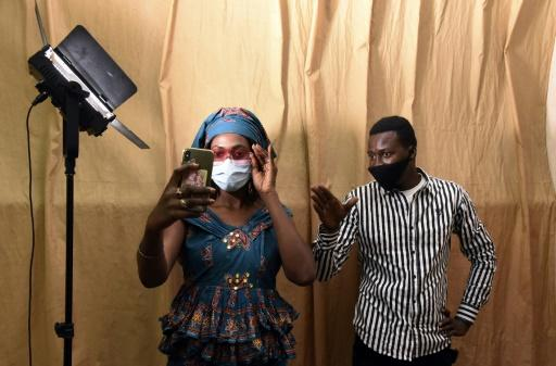 Masked rehearsals: Director Moustapha Kante and actress Aminata Diouf, who plays the role of Aby