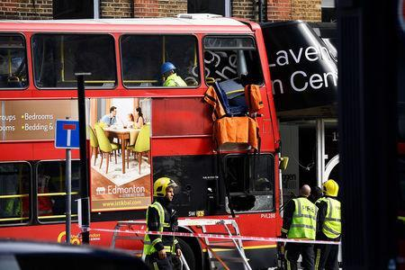 Emergency services attend the scene after a bus crashed into shops in Lavender Hill in Clapham, London, Britain, August 10, 2017. REUTERS/Dylan Martinez