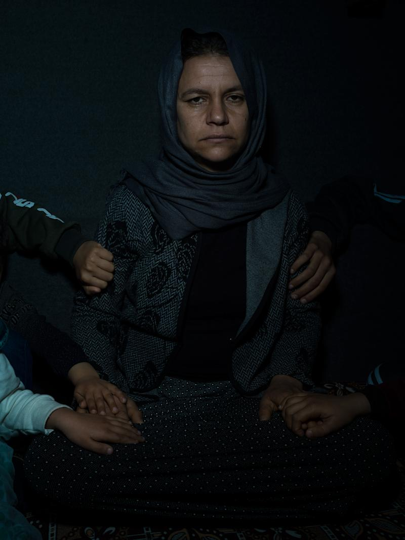 Subha, 35, and the hands of her children: Fahad, 15; Fahdi, 13; Linda, 10; Liza, 7; and Salam, 5. Photographed in February, they were captured by ISIS in 2014 and held as slaves until recently escaping the battle in Baghouz. Fahad, who had been trained as a fighter, led the way to safety. | Newsha Tavakolian—Magnum Photos for TIME