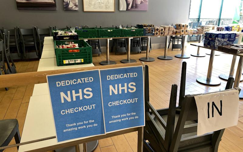 A dedicated NHS check out in Waitrose - Paul Childs/Reuters