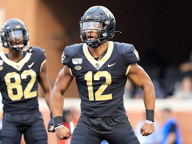 <p>Jamie Newman of Wake Forest reacts after scoring a touchdown against North Carolina during their game at BB&T Field on Sept. 13, 2019.</p>