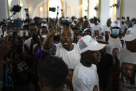 A man yells for justice during a memorial service for assassinated Haitian President Jovenel Moïse in the Cathedral of Cap-Haitien, Haiti, Thursday, July 22, 2021. Moïse was killed in his home on July 7. (AP Photo/Matias Delacroix)