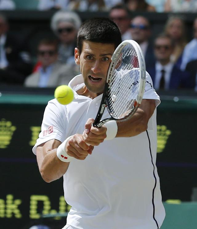 Novak Djokovic of Serbia plays a return to Roger Federer of Switzerland during their men's singles final match final at the All England Lawn Tennis Championships in Wimbledon, London, Sunday, July 6, 2014. (AP Photo/Ben Curtis)