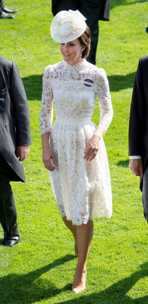 <p>For the first day of Royal Ascot, Kate made a regal entry with a lace Alexander McQueen dress, complemented by a white fascinator. The dress had a cinched waist, quarter-length sleeves and a high neckline. </p>