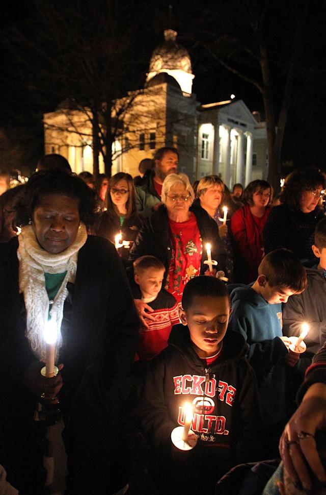 Hundreds of people gather on the court square in Shelby, N.C. to pray for victims of the Newtown, Conn. school shooting on Tuesday, Dec. 18, 2012. (AP Photo/The Star, Brittany Randolph)