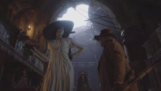 Lady Dimitrescu (yes, that Lady Dimitrescu) and Karl Heisenberg have a quarrel over who gets to eat me. Yay! Screen grab from Resident Evil: Village