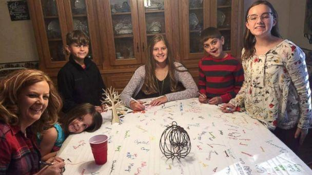 PHOTO: Deb Mills, of Clinton, Missouri, has everyone that joins them for Thanksgiving sign their name on her tablecloth. (Courtesy of Deb Mills)
