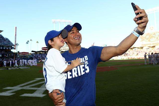 <p>Actor Mario Lopez takes a selfie on the field prior to Game 1 of the 2017 World Series between the Houston Astros and the Los Angeles Dodgers at Dodger Stadium on Tuesday, October 24, 2017 in Los Angeles, California. (Photo by Alex Trautwig/MLB Photos via Getty Images) </p>