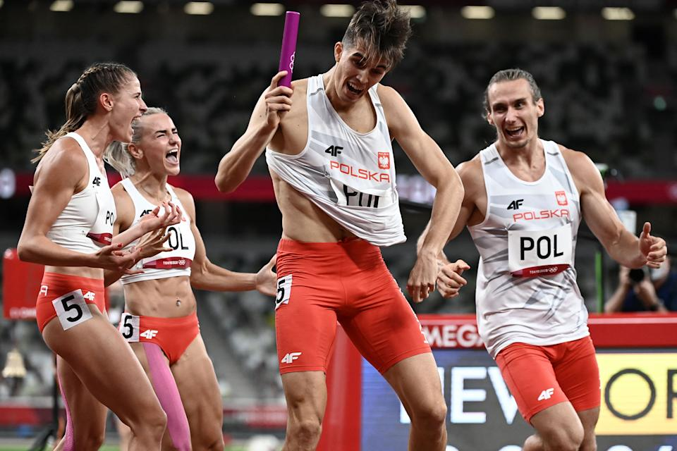 Poland's celebrate winning the mixed 4x400m relay final during the Tokyo 2020 Olympic Games at the Olympic Stadium in Tokyo on July 31, 2021. (Photo by Jewel SAMAD / AFP) (Photo by JEWEL SAMAD/AFP via Getty Images)