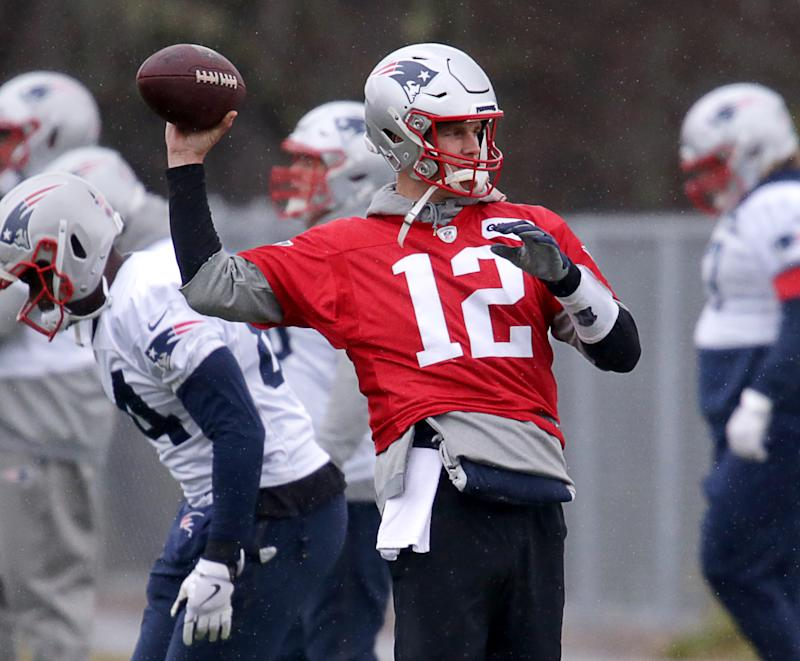 New England Patriots quarterback Tom Brady, shown here at practice on Wednesday, was added to the team's injury report on Friday. (Jonathan Wiggs/Globe Staff/Getty Images)