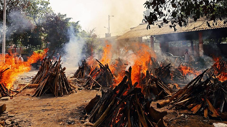 Funeral pyres of Covid-19 fatalities, pictured here burning at a crematorium in New Delhi, India.