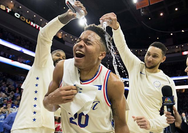 Apr 11, 2018; Philadelphia, PA, USA; Philadelphia 76ers guard Markelle Fultz (20) is doused with water by guard Ben Simmons (25) and center Amir Johnson (5) after recording his first triple double in a game against the Milwaukee Bucks at Wells Fargo Center. Mandatory Credit: Bill Streicher-USA TODAY Sports TPX IMAGES OF THE DAY