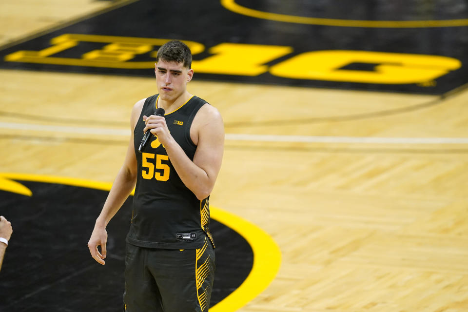 Iowa center Luka Garza speaks folllowing a video tribute after an NCAA college basketball game against Wisconsin, Sunday, March 7, 2021, in Iowa City, Iowa. Garza, a senior, was playing his last home game at Iowa. Iowa won 77-73. (AP Photo/Charlie Neibergall)
