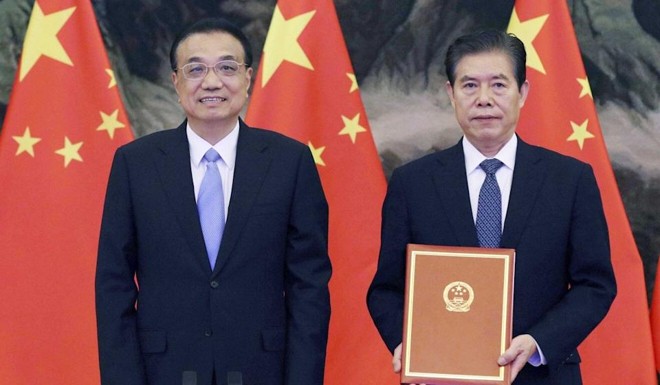Chinese Premier Li Keqiang (left) attends the signing ceremony of the RCEP agreement at the Great Hall of the People in Beijing. Photo: Xinhua