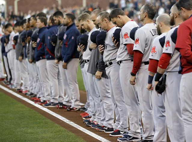 Member of the Boston Red Sox observe a moment of silence during a ceremony honoring victims of the Boston marathon bombings before a baseball game against the San Francisco Giants on Monday, Aug. 19, 2013, in San Francisco. (AP Photo/Marcio Jose Sanchez)