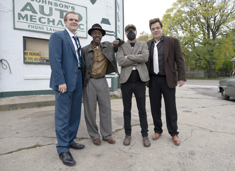 """This image released by Warner Bros. Entertainment shows director Steven Soderbergh, second from right, with actors, from left, David Harbour, Don Cheadle and Benicio Del Toro, right, on the set of """"No Sudden Move."""" (Claudette Barius/Warner Bros. Entertainment via AP)"""