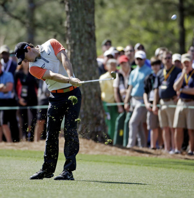 Rory McIlroy, of Northern Ireland, hits on the first fairway during the first round of the Masters golf tournament Thursday, April 10, 2014, in Augusta, Ga. (AP Photo/Darron Cummings)