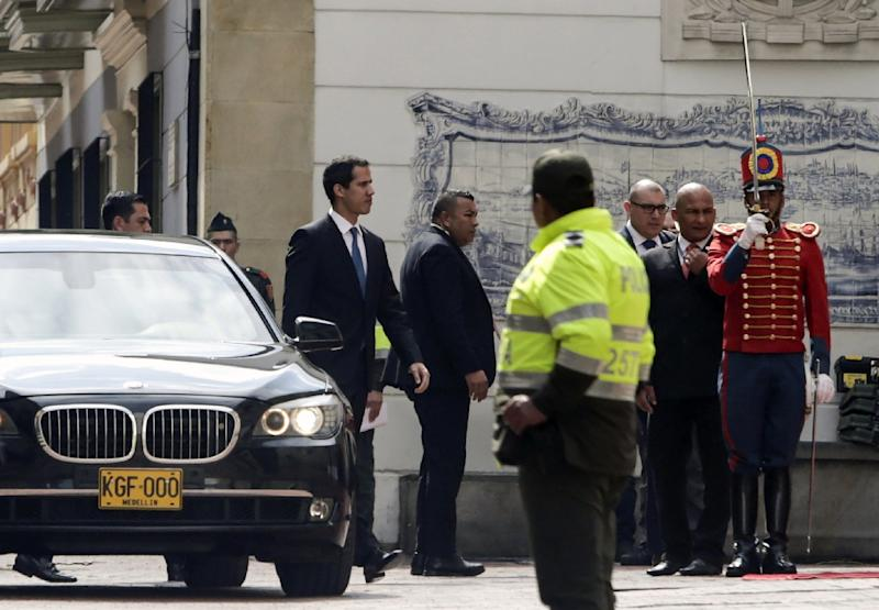 Venezuelan opposition leader and self-declared acting president Juan Guaido (C) arrives at the Foreign Affairs Ministry in Bogota for a meeting with regional allies (AFP Photo/Juan Manuel Barrero Bueno)