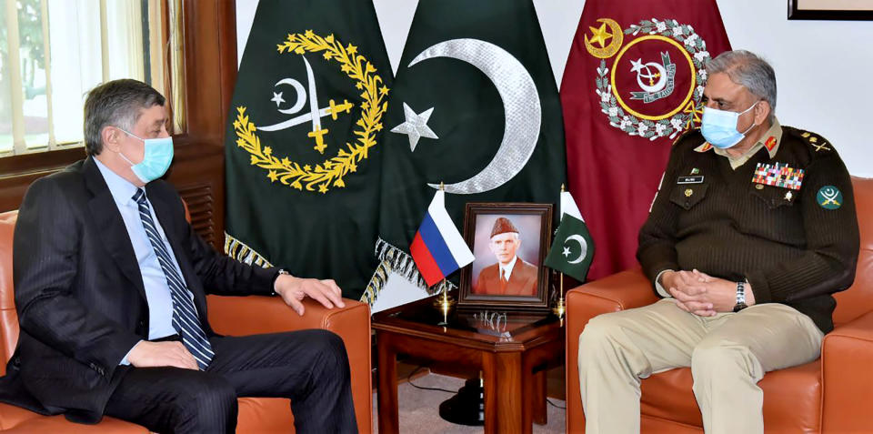 In this photo released by Inter Services Public Relations, Zamir Kabulov, left, Russia's President Vladimir Putin's special envoy on Afghanistan meets with Pakistan's Army Chief General Qamar Javed Bajwa, I Rawalpindi, Pakistan, Friday, Feb. 19, 2021. Kabulov was in Pakistan, a key regional player in efforts to find a peaceful end to Afghanistan's protracted war. During his unannounced visit , Kabulov met Pakistan's powerful army chief as well as the foreign minister. Few details came out of the meeting except that Afghanistan and getting to a peace deal dominated talks. Last month a delegation of the Taliban was in Moscow. (Inter Services Public Relations via AP)