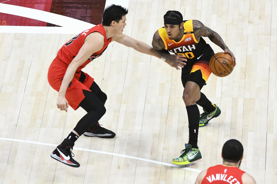SALT LAKE CITY, UTAH - MAY 01: Jordan Clarkson #00 of the Utah Jazz drives into Yuta Watanabe #18 of the Toronto Raptors during a game at Vivint Smart Home Arena on May 1, 2021 in Salt Lake City, Utah. NOTE TO USER: User expressly acknowledges and agrees that, by downloading and/or using this photograph, user is consenting to the terms and conditions of the Getty Images License Agreement.  (Photo by Alex Goodlett/Getty Images)