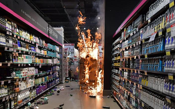 Products burn at a supermarket Carrefour in Sao Paulo, Brazil - AFP