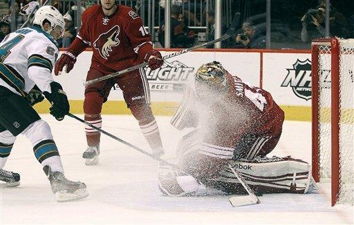 Phoenix Coyotes' goalie Mike Smith is sprayed with ice from San Jose Sharks' Jamie Mcginn in the first period of their NHL hockey game Saturday, Feb, 4, 2012 in Glendale, Ariz. (AP Photo/Darryl Webb)