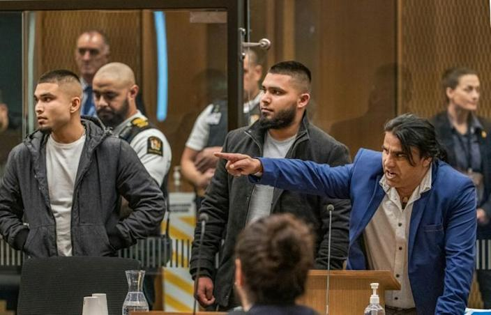 Abdul Aziz (R), who was hailed a hero when he chased the gunman from the Linwood mosque, gestures towards Australian white supremacist Brenton Tarrant at his sentence hearing in Christchurch