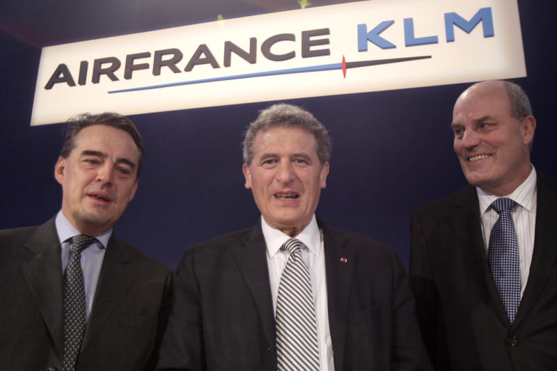 """CEO of Air France-KLM, Jean-Cyril Spinetta, center, CEO of Air France, Alexandre de Juniac, left, and Peter Hartman President and CEO of KLM, right, pose as they arrive for a press conference to announce the full year results in Paris, Thursday, March 8, 2012.  Air France-KLM on Thursday reported a multimillion euro loss for 2011, which the struggling carrier called a """"tough year"""" beset by volatile fuel prices, political upheaval and a lackluster global economy. (AP Photo/Michel Euler)"""