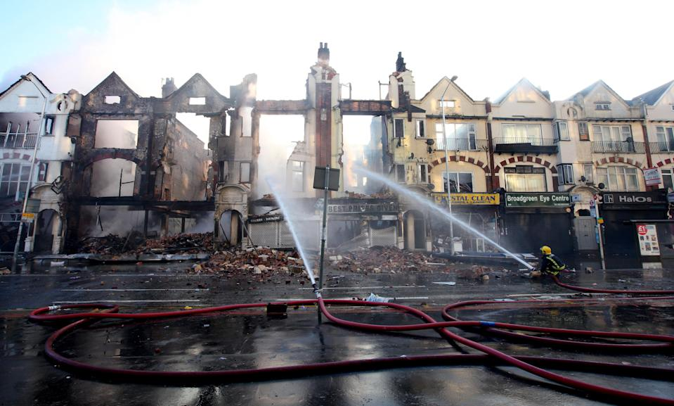 Fire crews douse burnt-out buildings in Croydon during riots in 2011 (Gareth Fuller/PA) (PA Archive)