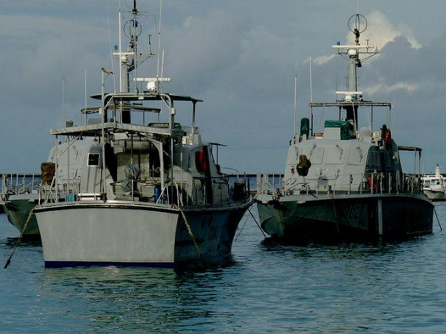 Coast Guard vessels are seen from the pier. Over 99 percent of the Maldives is open ocean. Besides its obvious military role, the Maldivian Coast Guard is also entrusted with addressing drug trafficking, maritime terrorism, smuggling and piracy.