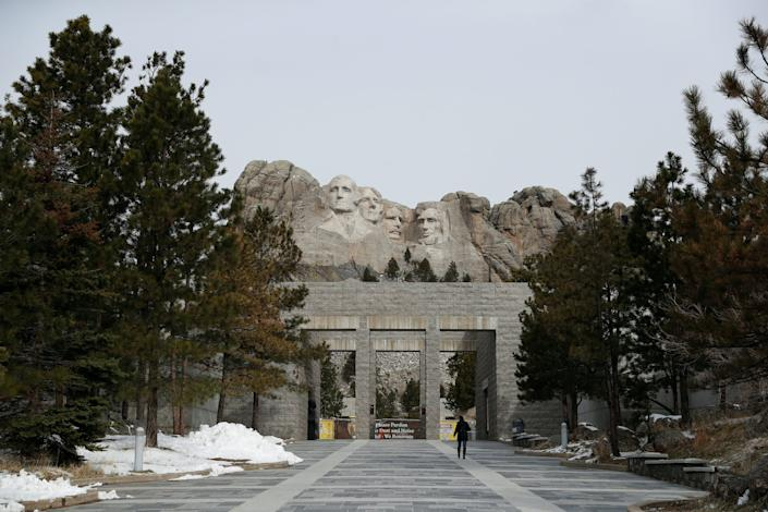 A woman walks at the Mount Rushmore National Memorial as the spread of the coronavirus disease (COVID-19) continues, where the Information Center is closed and all educational and interpretive programs are suspended in Keystone, South Dakota, on April 16, 2020.