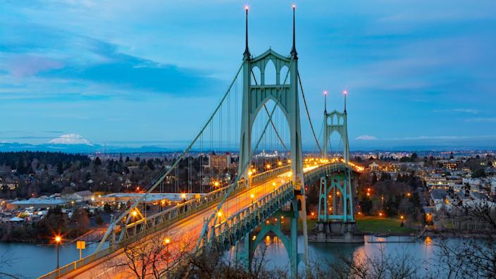 St Johns Bridge over the Willamette River in Portland, Oregon with Mt St Helens and Mt Adams in the background.