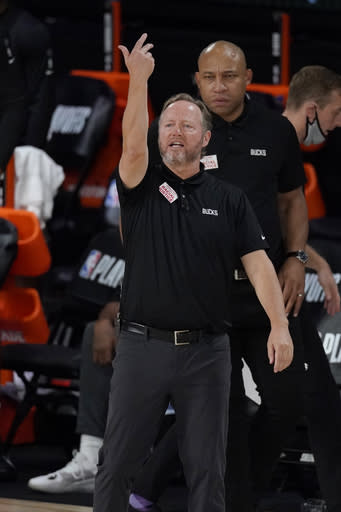 Milwaukee Bucks head coach Mike Budenholzer gesture in the second half of an NBA conference semifinal playoff basketball game against the Miami Heat Tuesday, Sept. 8, 2020 in Lake Buena Vista, Fla. (AP Photo/Mark J. Terrill)