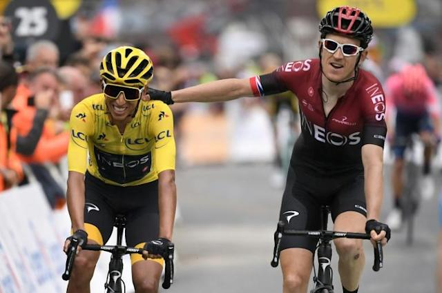 Colombia's Egan Bernal in the yellow jersey in 2019 is congratulated by teammate and 2018 champion Britain's Geraint Thomas (AFP Photo/Marco Bertorello)