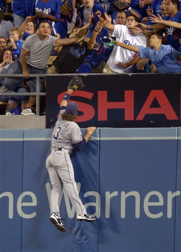 San Diego Padres right fielder Chris Denorfia can't reach a ball hit for a solo home run by Los Angeles Dodgers' Andre Ethier during the second inning of their baseball game, Tuesday, Sept. 4, 2012, in Los Angeles. (AP Photo/Mark J. Terrill)