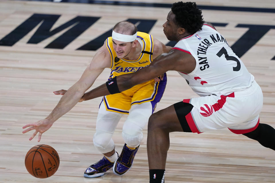 Toronto Raptors' OG Anunoby (3) tries to steal the ball from Los Angeles Lakers' Alex Caruso during the first half of an NBA basketball game Saturday, Aug. 1, 2020, in Lake Buena Vista, Fla. (AP Photo/Ashley Landis, Pool)