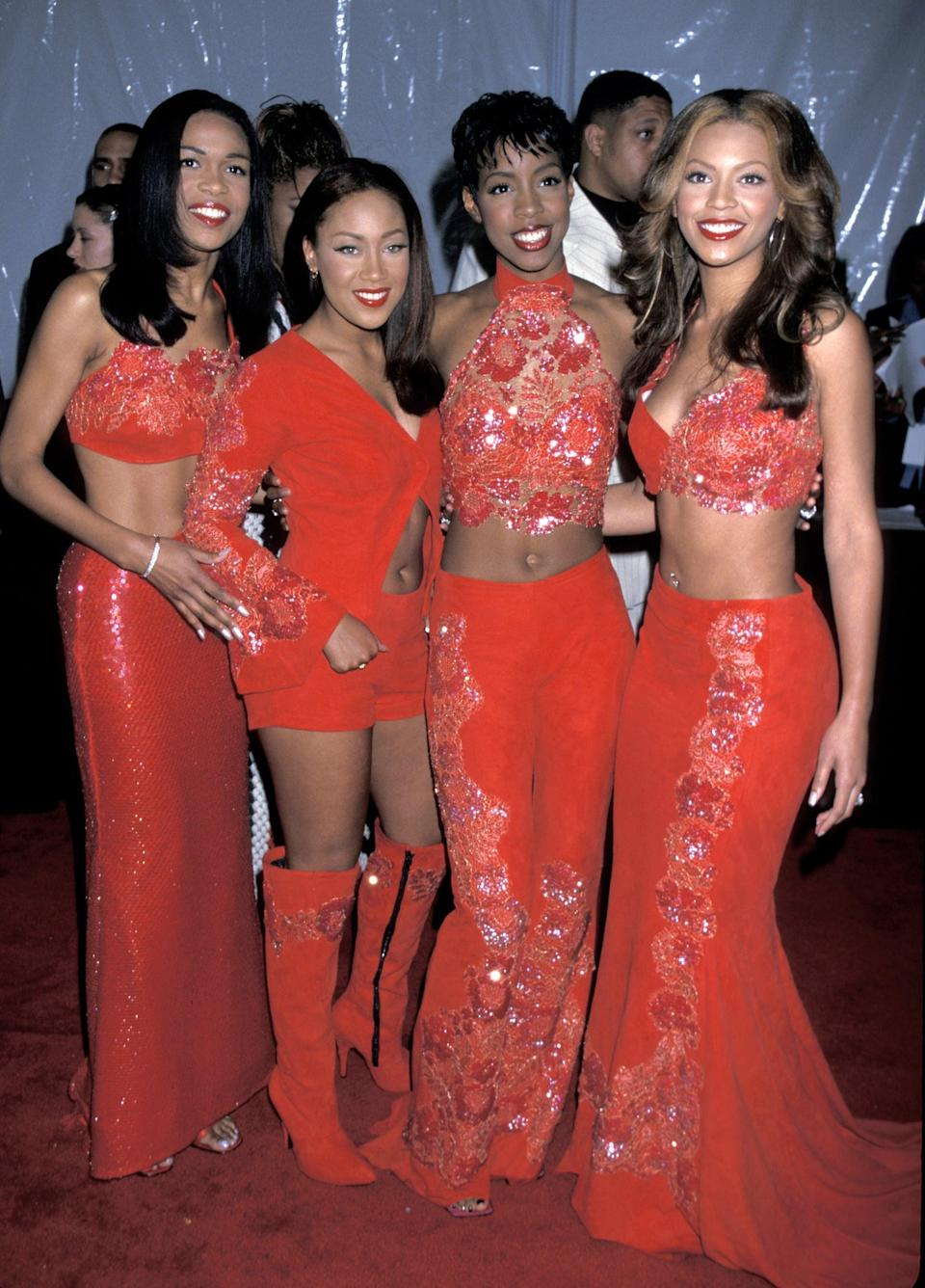 <p>At the 1999 Soul Train Music Awards wearing coordinated red embroidered outfits.</p>