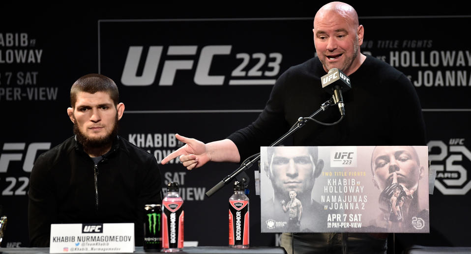 Khabib Nurmagomedov (L) and Dana White interact with media and fans during the UFC 223 media day at the Music Hall of Williamsburg on April 4, 2018 in Brooklyn, New York. (Getty Images)