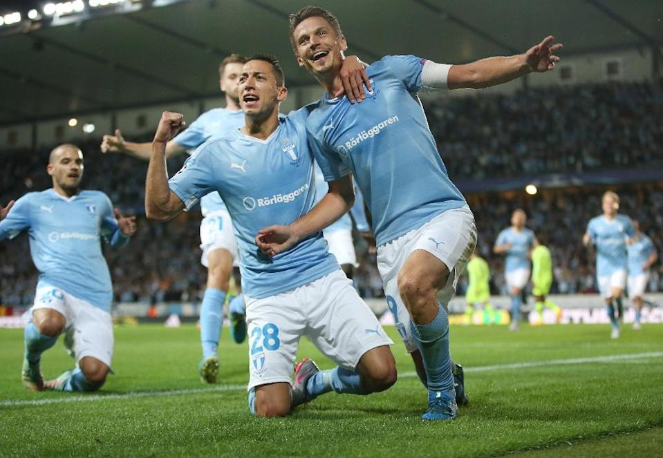Malmo's Markus Rosenberg (R) celebrates with his teammate Nikola Djurdjic during the UEFA Champions League play-off second leg match against Celtic at Malmo New Stadium, in Malmo, Sweden, on August 25, 2015 (AFP Photo/Andreas Hillergren)