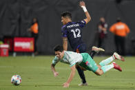 Seattle Sounders' Fredy Montero (12) and Club Leon's Victor Davila (7) battle for the ball during the first half of the Leagues Cup soccer final Wednesday, Sept. 22, 2021, in Las Vegas. (AP Photo/John Locher)