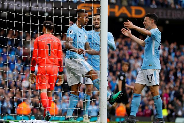 "Soccer Football - Premier League - Manchester City v Swansea City - Etihad Stadium, Manchester, Britain - April 22, 2018 Manchester City's Gabriel Jesus celebrates scoring their fifth goal with Phil Foden and Bernardo Silva REUTERS/Phil Noble EDITORIAL USE ONLY. No use with unauthorized audio, video, data, fixture lists, club/league logos or ""live"" services. Online in-match use limited to 75 images, no video emulation. No use in betting, games or single club/league/player publications. Please contact your account representative for further details."