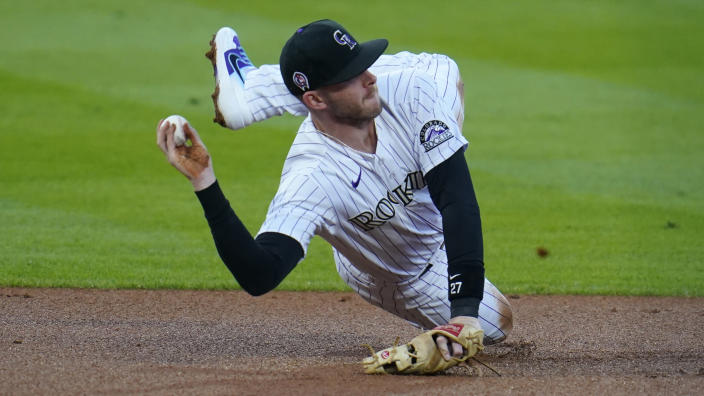 FILE - wldColorado Rockies shortstop Trevor Story throws after fielding a ground ball against the Los Angeles Angels in the first inning of a baseball game in this file photograph taken Friday, Sept. 11, 2020, in Denver. Story, who will be a free agent at the end of the 2021 season, has become the face of the Rockies with the trade of third baseman Nolan Arenado to St. Louis. (AP Photo/David Zalubowski, File)