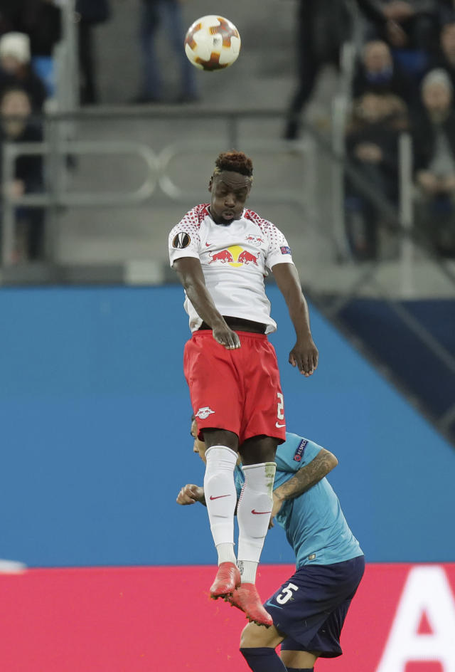 Leipzig's Jean-Kevin Augustin jumps above Zenit's Leandro Paredes during the Europa League round of sixteen second leg soccer match between Zenit St. Petersburg and Leipzig, at the Saint Petersburg stadium in St.Petersburg, Russia, Thursday, March 15, 2018. (AP Photo/Dmitri Lovetsky)