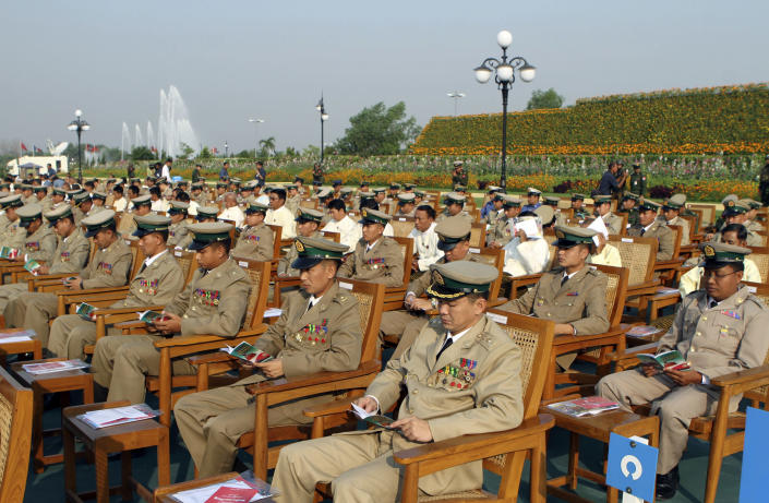 Myanmar military officials attend a ceremony marking the country's 67th Armed Forces Day in Naypyitaw, Myanmar, on Tuesday, March 27, 2012. (AP Photo/Khin Maung Win)