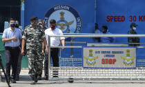 Indian paramilitary officials come out of the Jammu air force station after two suspected blasts were reported early morning in Jammu, India, Sunday, June 27, 2021. Indian officials said Sunday they suspected explosives-laden drones were used to attack the air base in the disputed region of Kashmir, calling it the first such incident of its kind in India. (AP Photo/Channi Anand)